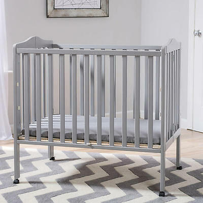 New Delta Children Portable Folding Crib with Mattress - Grey Model:24701444