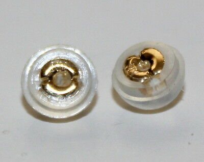 A pair  14k solid gold  STOPPER
