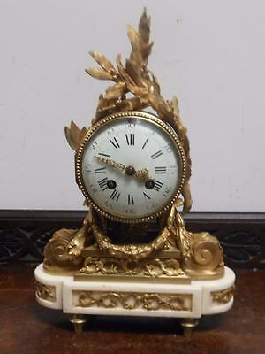 unusual style french bronze and marble  mantel clock by marti  visible pendulumn