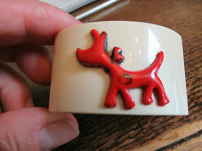 Vintage 1950's celluloid Napkin ring with cute dog on the front.