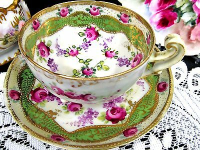 Stunning Nippon tea cup and saucer 3 FOOTED teacup painted roses & gold gilt
