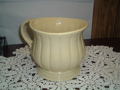 Antique yellow ribbed chamber pot
