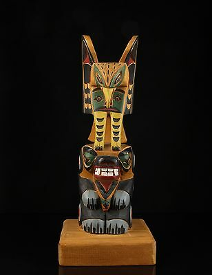 """A Vintage North American Carved Wood Totem Pole, Signed """"R. G. Huxley""""."""