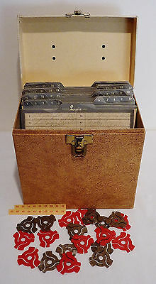 32 ORIGINAL 45-rpm ROCK 'N ROLL RECORDS with CARRYING CASE