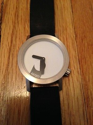 $100+ AKTEO Round black/white Rubber band WATCH by J.C. Mareschal, FRANCE