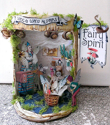 altered art mixed media fairy wand and wing repair tree stump diorama