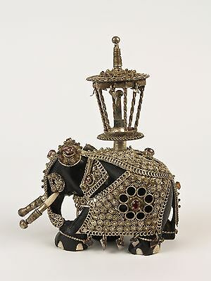 A Mid 20th c. Indian Silver Mounted and Bejewelled Ebony Elephant.