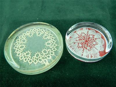 Two glass paperweights both with lace in them