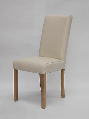 Darota solid oak furniture set of four cream leather dining chairs