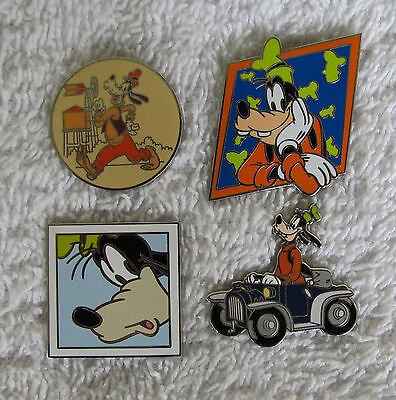 Disney 4  Pins  GOOFY  Travel co in car  starter   AUTHENTIC