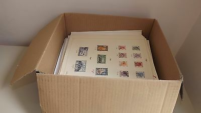 World Stamp Collection On Pile Of Album Pages 7875 Stamps