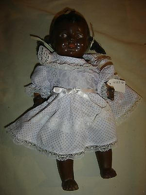 Antique Black Composition Baby Doll - jointed body- flirty eyes - 9571