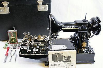 Singer Featherweight 222K Electric Sewing machine with Case & Attachments