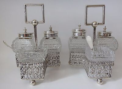 A pair of hallmarked solid silver cruet sets & condiments 1906 & Chester 1916