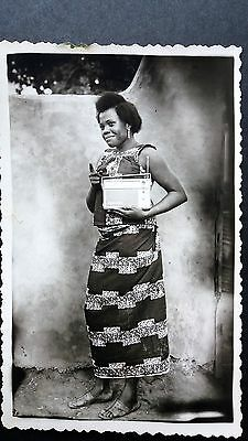 Vintage (1960) RPPC of  Nigerian girl with her radio.