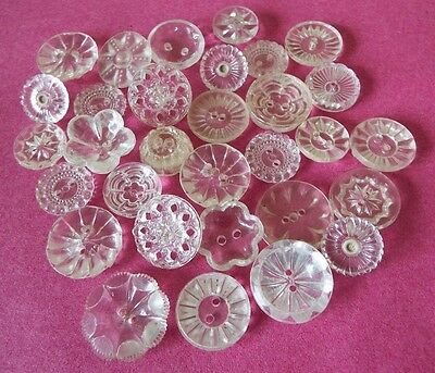 30 old/vintage clear plastic or lucite buttons with a flower theme or pattern