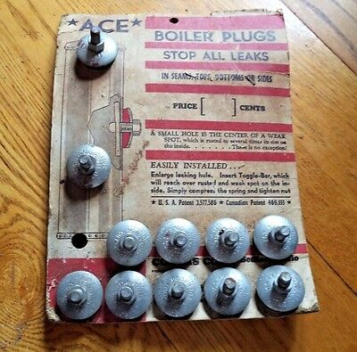 antique ACE boiler plugs on display card