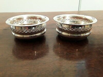 A pair of silver plate wine coasters