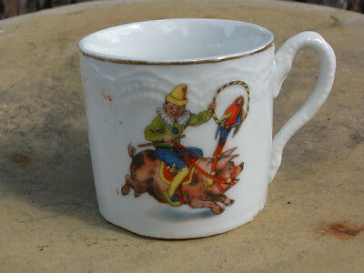 Childs Antique Porcelain Embossed & TransferWare Mug with Clown Riding On Pig