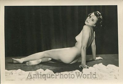 Beautiful nude woman posing on floor antique pin up photo