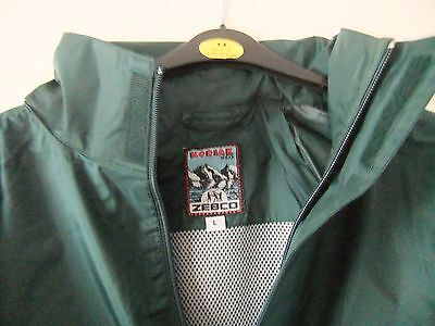 new Zebco two piece water resistant suit in Large, jacket with hood and trousers