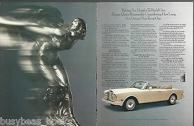 1990 ROLLS ROYCE 2-page advertisement, hood mascot close-up photo