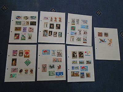 collection of stamps Rwandaise hinged on album pages (a)
