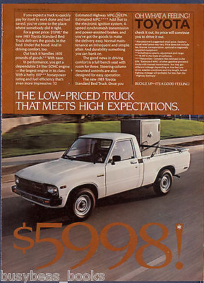 1983 TOYOTA Pickup advertisement, Toyota pickup carrying large safe