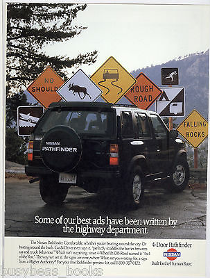 1991 NISSAN PATHFINDER advertisement, large SUV, road signs, Canadian advert