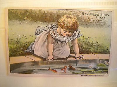 REYNOLDS BROS. FINE SHOES Victorian TRADE CARD CHROMOLITHO girl fish UTICA NY