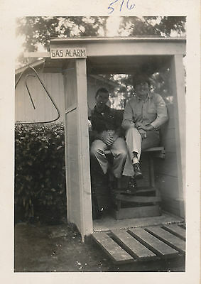 1940s WWII 2 solders sitting next to Gas Alarm Triangle  Hawaii Photo