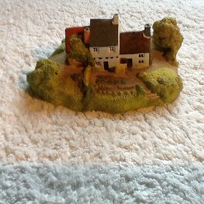 Painted model cottage and garden
