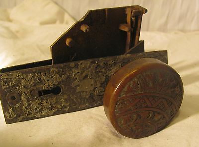 antique door handle and lock mechanism, tulip design, neat