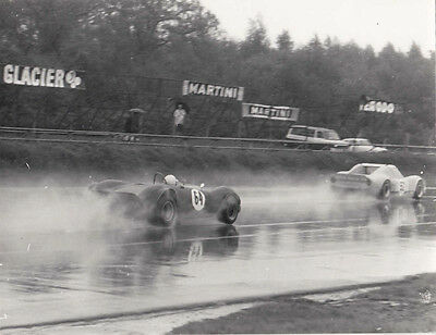 SPORTS CARS No.52 & 64 RACING IN WET, PERIOD PHOTOGRAPH.