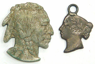 A pair of cut out coin busts