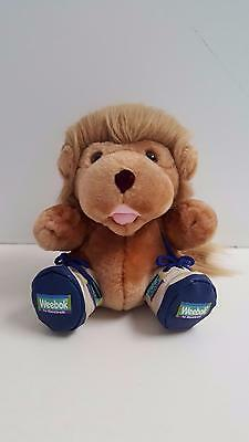 Willoughby Weebok Lion plush toy by Reebok wearing blue & white sneakers