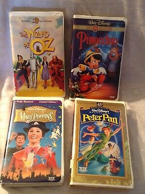 Lot of 4 Vintage Walt Disney, WB Classic VHS video tapes. OZ, Poppins, Pan, NICE
