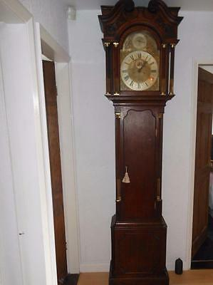 great quality brass dial oak longcase clock by maple & co london,1/2 hour strike