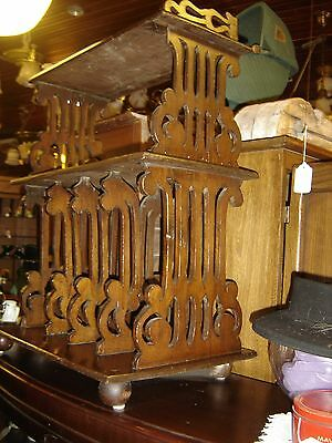 Antique Pierced Walnut Magazine or Plate Rack with 4 ball feet with gallery.8202