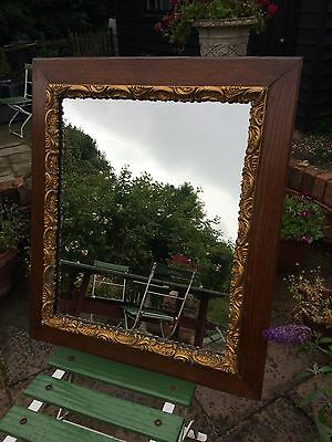 French oak-framed/gilded wall mirror early C.20th