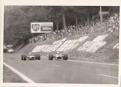 Two Single Seater Racing Cars Passing Bp Sign Photograph.
