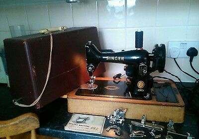 Singer sewing machine 99k lovely working condition with attatchments case foot