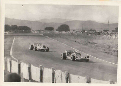 Two Single Seaters Racing, Photograph.