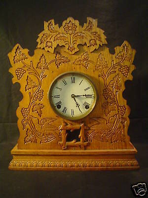 AMERICAN GILBERT SHELF / MANTLE CLOCK, CARVED WOOD CASE, c. 1900