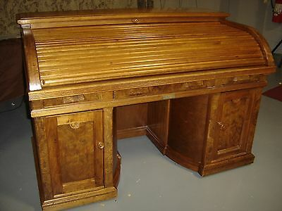 Superb Burled Walnut Wooten Rotary Desk with leather top writing surface. 9057