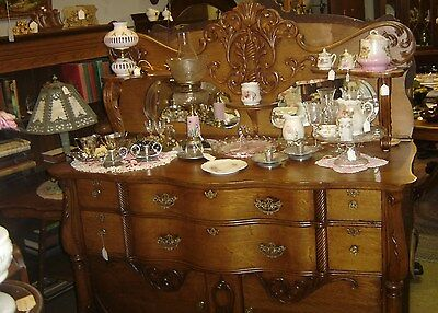 """Ornate Antique Oak Sideboard with two shaped """"cat eye"""" beveled mirrors.   7494"""