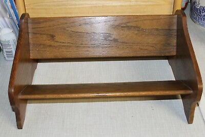 A small oak vintage  book trough in good condition.