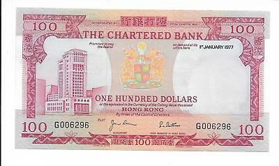 The Chartered Bank - $100, 1977. AU - Unc.