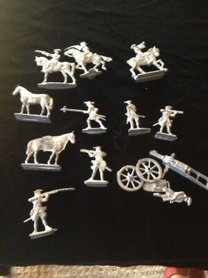 Unpainted Lead Soldiers And Horses