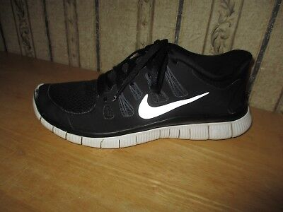 PRE-OWNED women's black / white NIKE FREE 5.0 athletic shoes - size 9